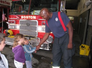 The kids meeting Leigh's friend, the firefighter, who gave them a private tour!