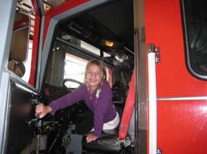 Reese feeling right at home in the fire truck