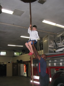 Koby sliding down the pole ... with assistance