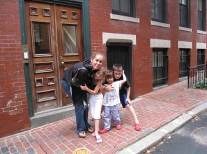Leigh with the kids outside her very cute apartment