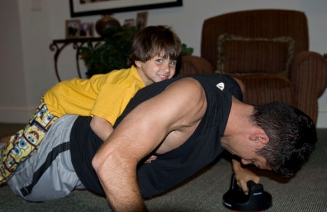 Chase trying to hitch a ride on STRONG Ryan.  Show-off!
